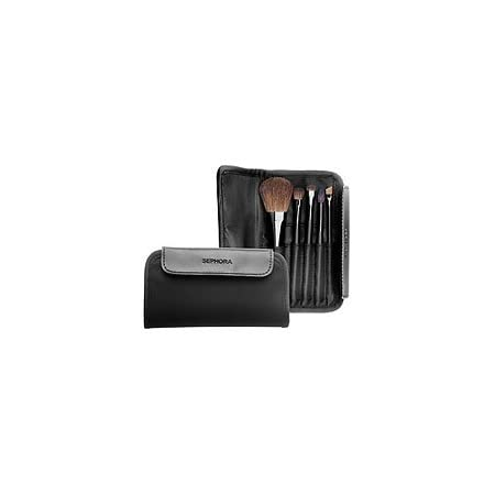 Sized to slip easily into your purse or briefcase, this soft microfiber brush portfolio has a magnetic flap closure and houses five professional quality brushes for the face and eyes.Set includes a powder/blush brush, eye shadow blending brush, eye s...