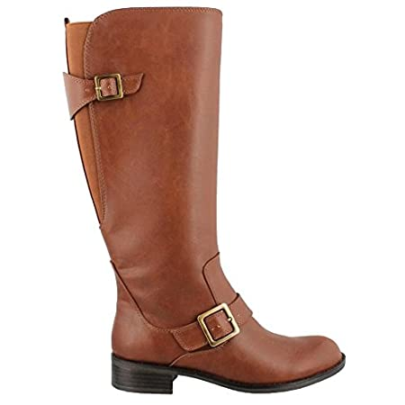 Sleek faux leather upper. Inside zipper entry and pull tab at heel provide easy on-and-off wear. Tonal elastic goring panels as calf. Adjustable buckle straps create a truly equestrian look. Knee-length shaft. Closed toe. Smooth synthetic lining and ...