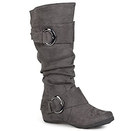 Complement your outfit with these slouchy mid-calf boots by Brinley Co. Buckle and strap details highlight the upper on these round toe boots. Constructed of soft faux suede uppers and rubber soles, man-made lining completes the look of these boots.A...