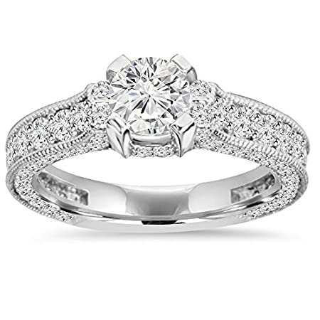 Womens ring features a 1/2ct center diamond and 88 diamonds set in solid 14k white gold.