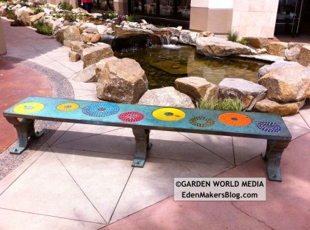 Custom mosaic tile bench in garden
