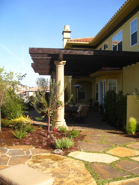 Sunset Patio For West Facing Yard With Stone Columns