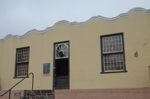 Museum House. The museum is distinguishable by its doorstep—a type of front terrace with a bench at each end emphasizing the polarizing aspect of Cape Muslim culture.