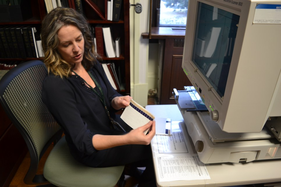 The Alberta Legislature Library's Heather Close showing us how the microform reader works. (Photo: Chris Chang-Yen Phillips)