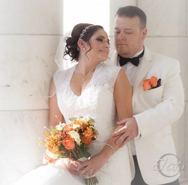 Bride and Groom at columns of Cheesman