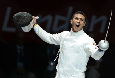 Venezuela's Ruben Limardo celebrates his victory over US fencer Weston Kelsey during their Men's epee semi final bout as part of the fencing event of London 2012 Olympic games, on August 1,  2012 at the ExCel centre in London. AFP PHOTO / TOSHIFUMI KITAMURA        (Photo credit should read TOSHIFUMI KITAMURA/AFP/GettyImages)