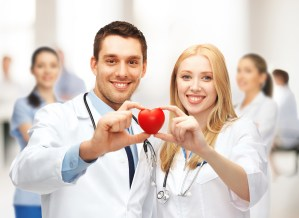 healthcare and medical concept - cardiologists with heart