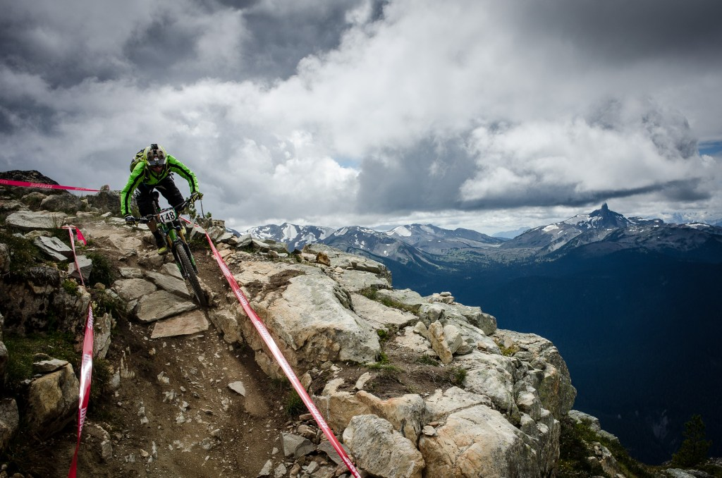 A racer practicing the Top of the World trail on Stage 2 of the 2015 Enduro World Series at Whistler in British Columbia.