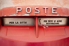 13193811 - old red vintage retro mailbox in italy