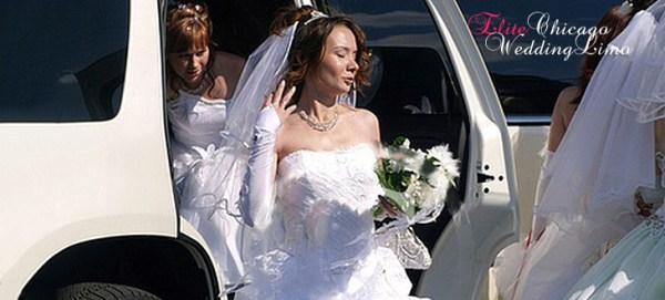 Bride in front of a Wedding Hummer H2 limousine