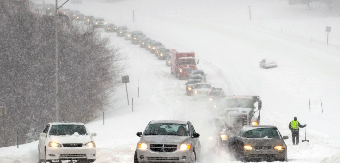 Image: Stalled vehicles are seen during a blizzard in Overland Park, Kansas
