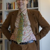 David in a flowery shirt and delicious brown cord suit - perfect for Parliament