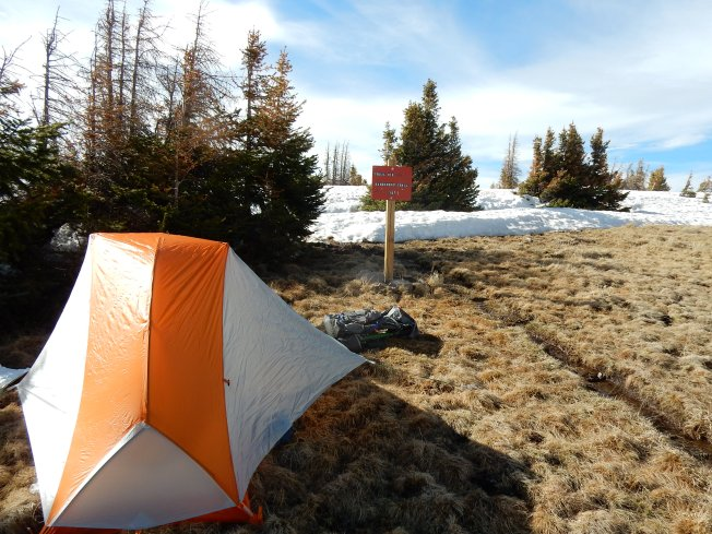 Campsite after the first day out of Cumbres Pass., The sign warms of dangerous conditions.