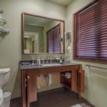 Pocket doors stow the front panels on the sink in the Redwood Room