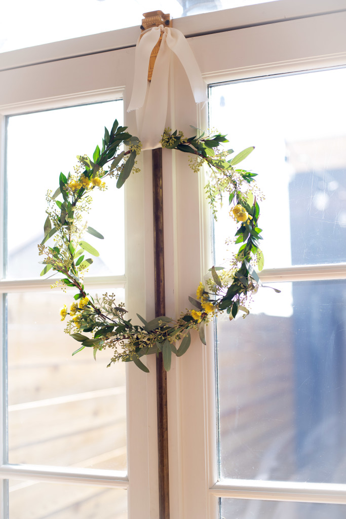 A Step by Step guide for making a simple spring wreath using a clothing hanger as the form.