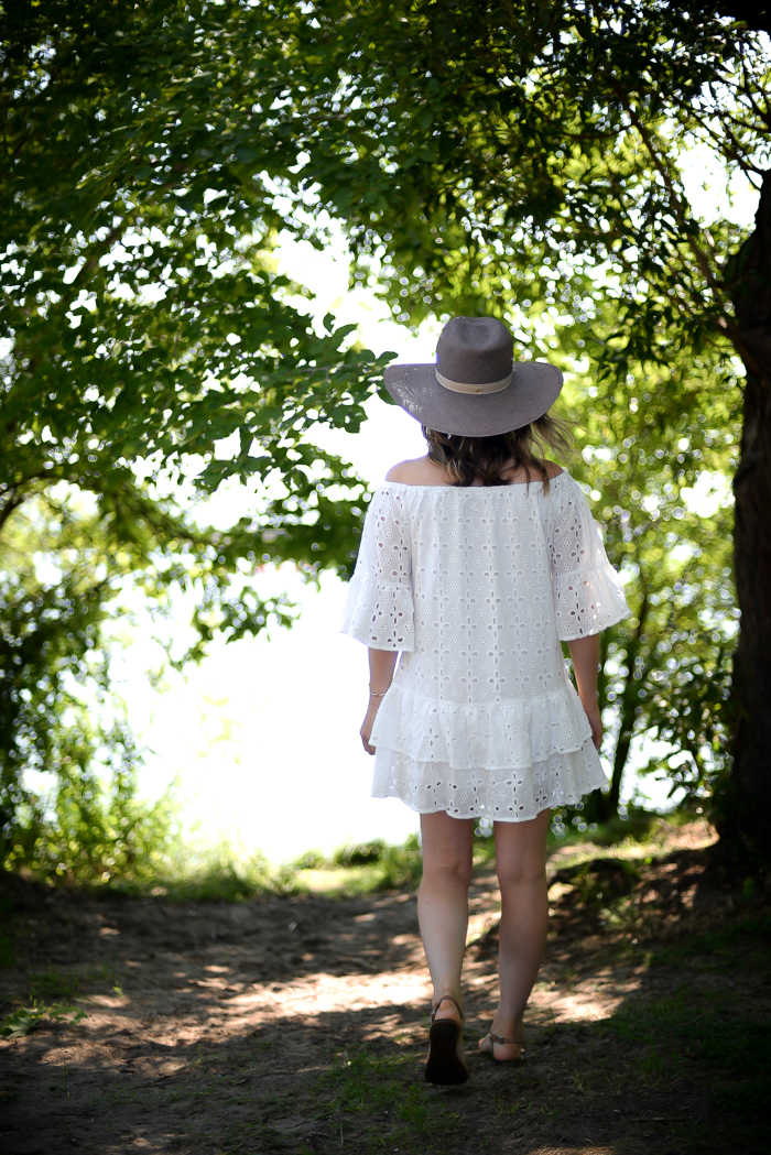 Blogger Threads & Blooms wearing white SheIn dress with embroidery