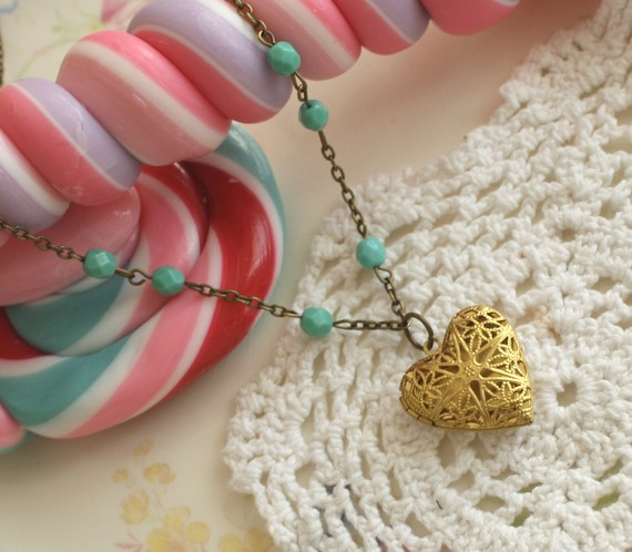 heart locket with antique brass chain and blue beads