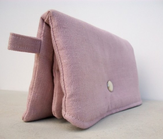 pink clutch purse side view