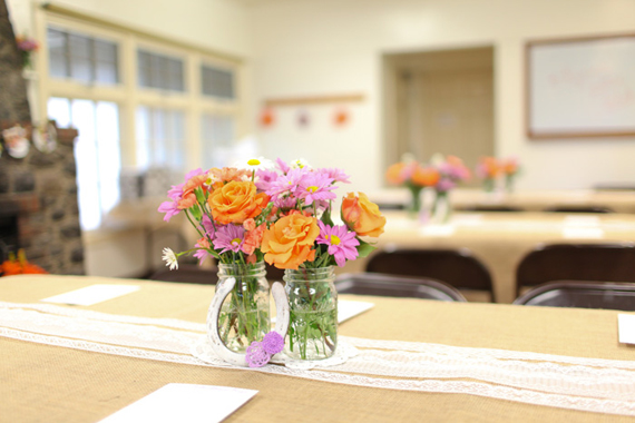 bridal shower flowers in vases as centerpieces
