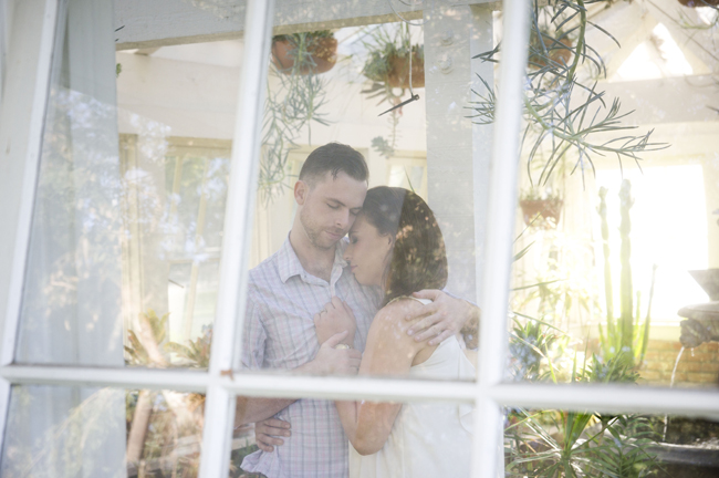 Santa Fe Springs Engagement Session with couple holding each other in greenhouse