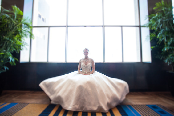 bride sitting in wedding dress at Lowes Hotel - Crystal Tea Room Wedding - photo: Daniel Fugaciu Photography | via http://emmalinebride.com