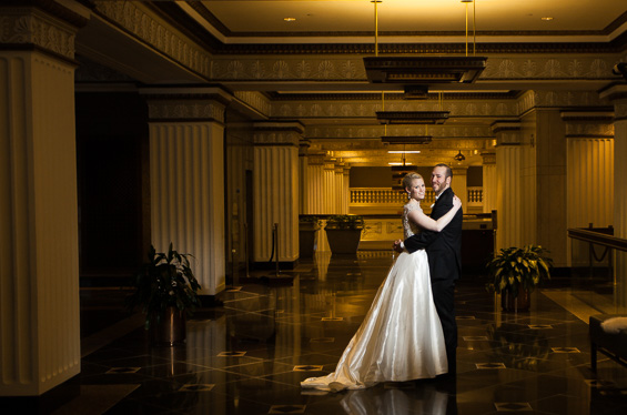 bride and groom pose in Lowes Hotel Lobby - Crystal Tea Room Wedding - photo: Daniel Fugaciu Photography | via http://emmalinebride.com
