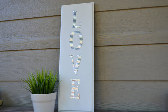 aluminum love sign via 27 Amazing Anniversary Gifts by Year http://emmalinebride.com/gifts/anniversary-gifts-by-year/