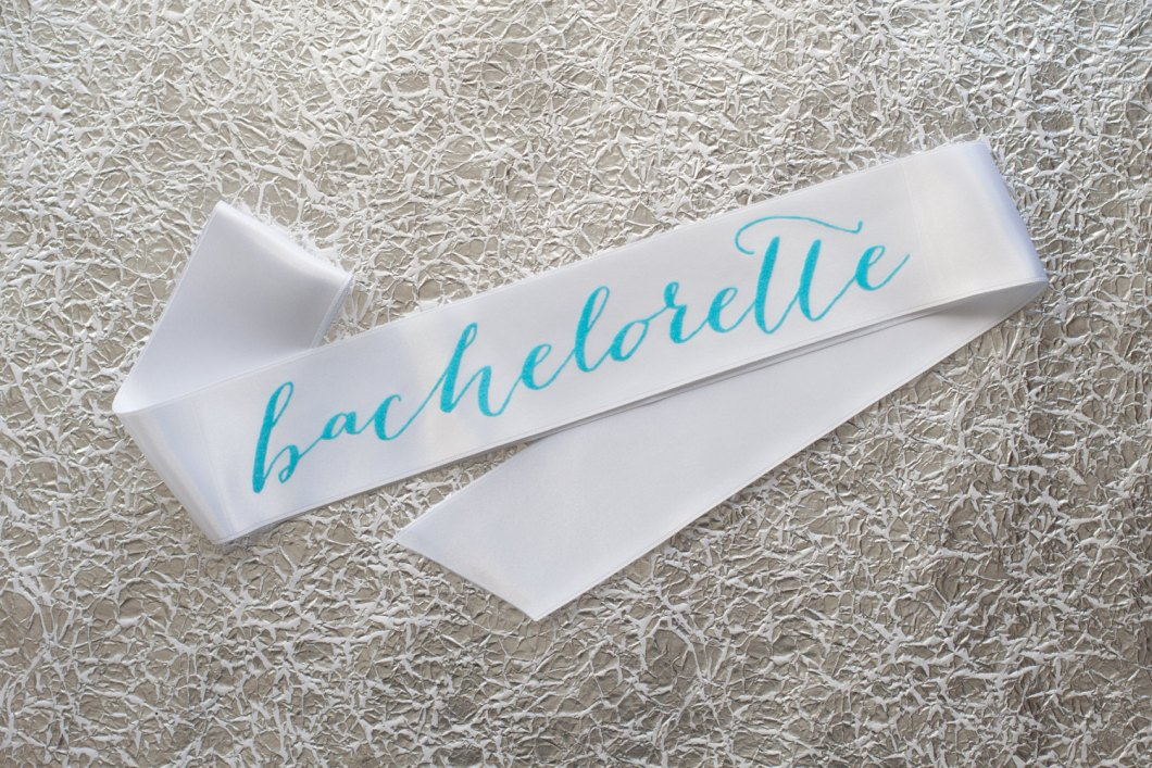 bachelorette sash with aqua writing | stylish bachelorette sash ideas | via http://emmalinebride.com/bride/bachelorette-sash-ideas/