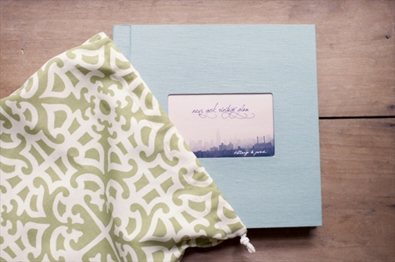 blue handmade wedding album with decorative bag