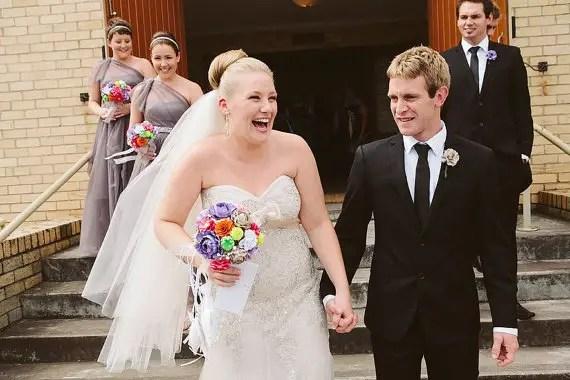 bride holding paper bouquet | wedding bouquets made of paper via emmalinebride.com