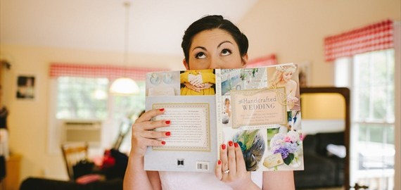 bride-holding-the-handcrafted-wedding-book