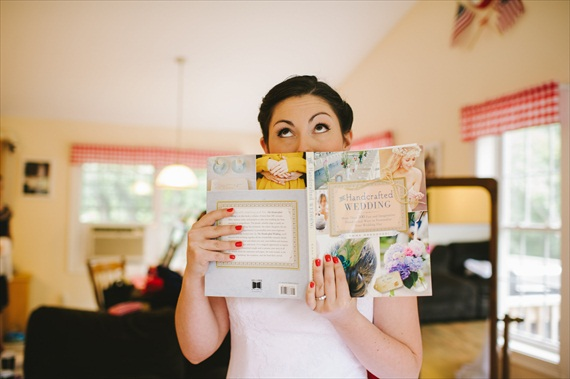 bride getting married holds her favorite wedding book, The Handcrafted Wedding