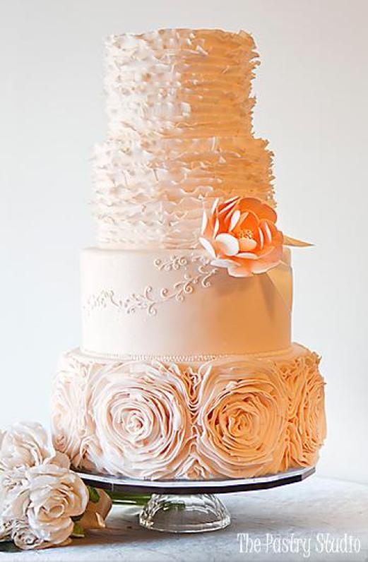 ruffly wedding cake with soft rosettes
