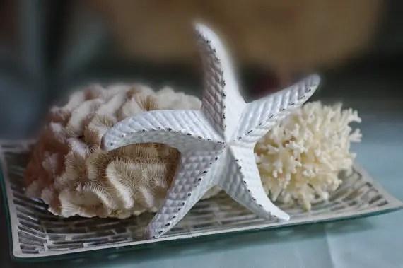 cast iron starfish decor | via starfish wedding ideas: http://emmalinebride.com/beach/starfish-wedding-ideas/