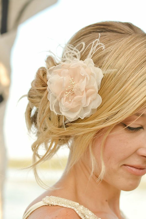 classic peach hair flower via 15 Stunning Wedding Veil Alternatives