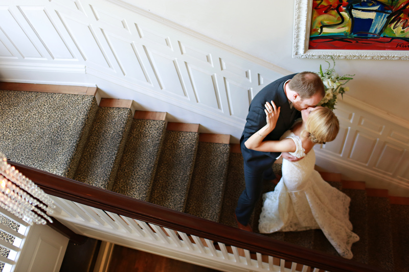 Bride and groom kissing on the stairs | Photographer: Melissa Prosser Photography | via http://emmalinebride.com/real-weddings/colleen-ryans-lovely-savannah-wedding-at-the-mansion-on-forsyth-park