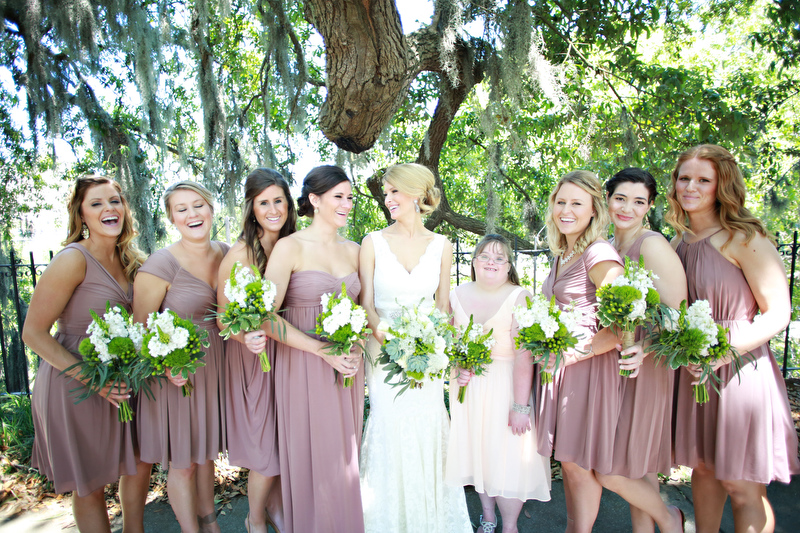 Bride with her bridesmaids, holding bouquets | Photographer: Melissa Prosser Photography | via http://emmalinebride.com/real-weddings/colleen-ryans-lovely-savannah-wedding-at-the-mansion-on-forsyth-park