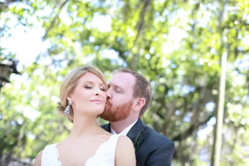 Groom kissing his bride | Photographer: Melissa Prosser Photography | via http://emmalinebride.com/real-weddings/colleen-ryans-lovely-savannah-wedding-at-the-mansion-on-forsyth-park
