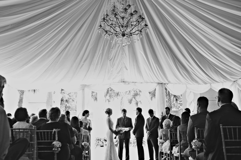 The bride and groom held their ceremony under a beautiful chandelier in a tented space, where the reception would occur shortly after. | Photographer: Melissa Prosser Photography | via http://emmalinebride.com/real-weddings/colleen-ryans-lovely-savannah-wedding-at-the-mansion-on-forsyth-park