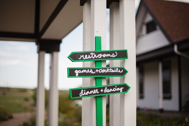 Signs leading the way for the wedding | Photo: Searching for the Light Photography LLC | via http://emmalinebride.com/real-weddings/colorado-chic-wedding-kendall-brian/