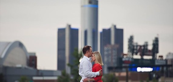 Downtown Detroit engagement photo in front of GM Renaissance Center, Tiger Stadium, Ford Field