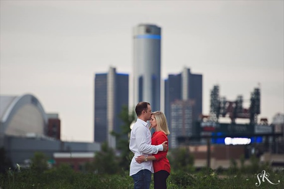 Downtown Detroit engagement photo in front of GM Renaissance Center, Comerica Park, Ford Field