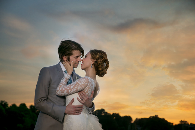 bride and groom hold each other at Connecticut waterfront wedding - photo: Melani Lust Photography | via http://emmalinebride.com