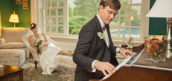 groom-playing-piano-for-bride-boro-photography-emmaline-bride