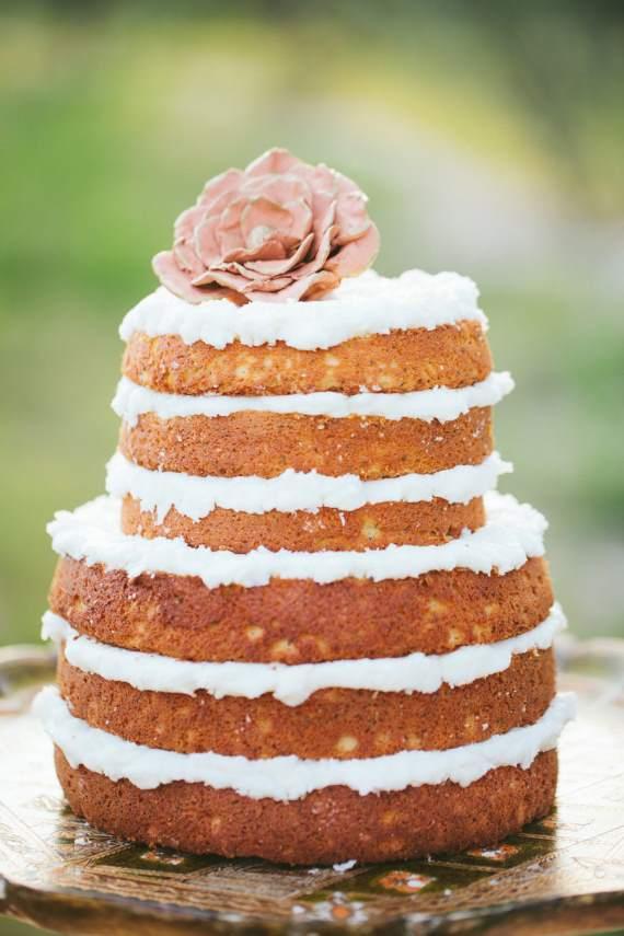Naked Wedding Cakes - This naked two-tiered wedding cake features a simple floral bloom.
