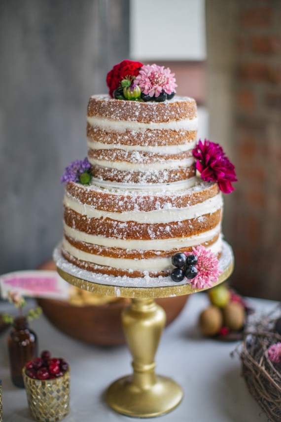 Naked wedding cakes - Add a dusting of powdered sugar and adorn the cake with floral blooms.