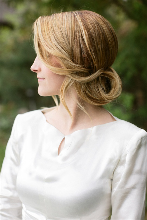 This ponytail flip updo, as shown from the side, is an elegant look for the bride or bridesmaid. By Hair and Makeup by Steph, photo by Ciara Richardson.