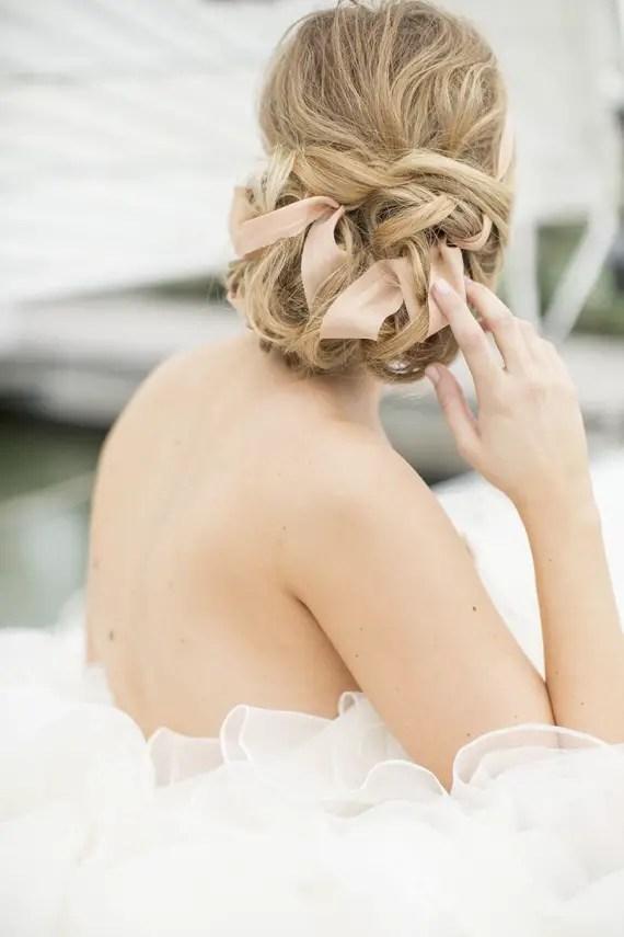 ribbon in bride's hair wedding hairstyle