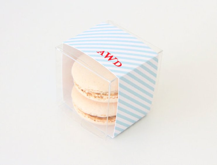blue and write striped monogram favor box for macarons | via http://emmalinebride.com/favors/giving-macaron-favors/