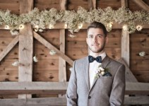 suit coat and bow tie barn wedding groom attire